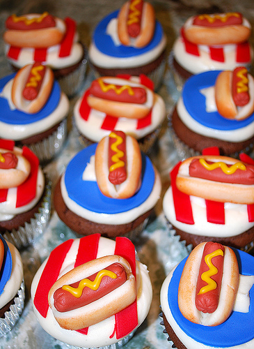 4th of july cupcakes decorated with hot dogs