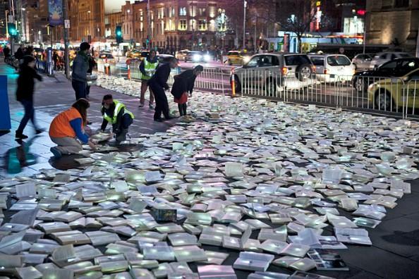 Literature vs traffic in Federation Square, Melbourne, by Luzinterruptus 2