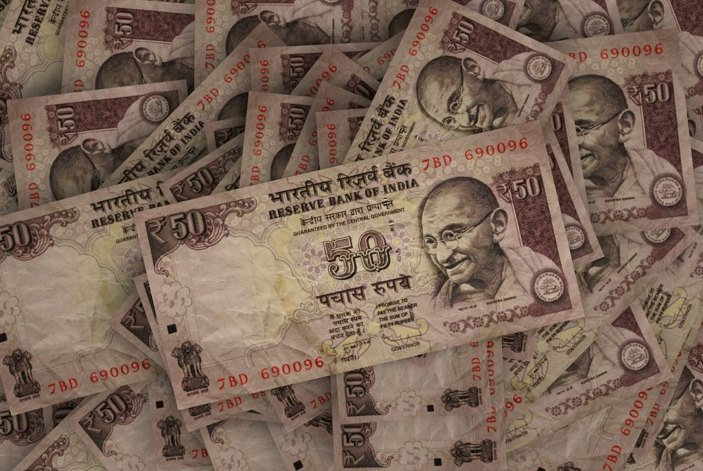 Oh look, in India they put Ben Kingsley on the money but they really messed up his eyebrows